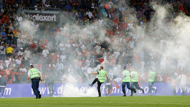 Soccer Football - International Friendly - Tunisia vs Turkey - Stade de Geneve, Geneva, Switzerland - June 1, 2018 Fans throw a smoke canister on to the pitch REUTERS/Denis Balibouse