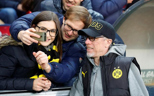 Soccer Football - Europa League Round of 16 Second Leg - RB Salzburg vs Borussia Dortmund - Red Bull Arena Salzburg, Salzburg, Austria - March 15, 2018 Borussia Dortmund coach Peter Stoeger poses for a photograph with fans before the match REUTERS/Leonhard Foeger