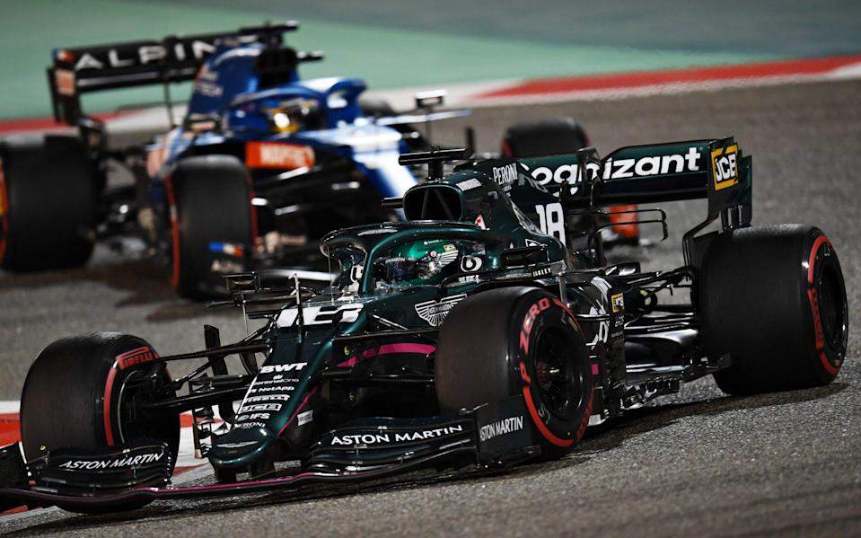 Lance Stroll of Canada driving the (18) Aston Martin AMR21 Mercedes leads Fernando Alonso of Spain driving the (14) Alpine A521 Renault on track during the F1 Grand Prix of Bahrain at Bahrain International Circuit on March 28, 2021 in Bahrain, Bahrain - Clive Mason - Formula 1