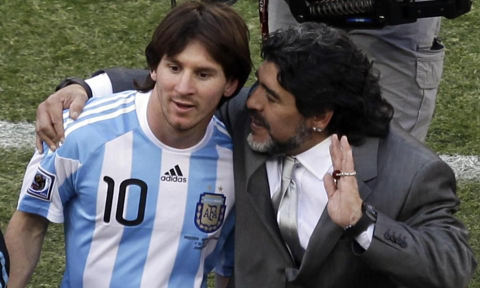 Lionel Messi (left) leaves the pitch with the Argentina head coach Diego Maradona after a 4-1 win over South Korea at the 2010 World Cup.