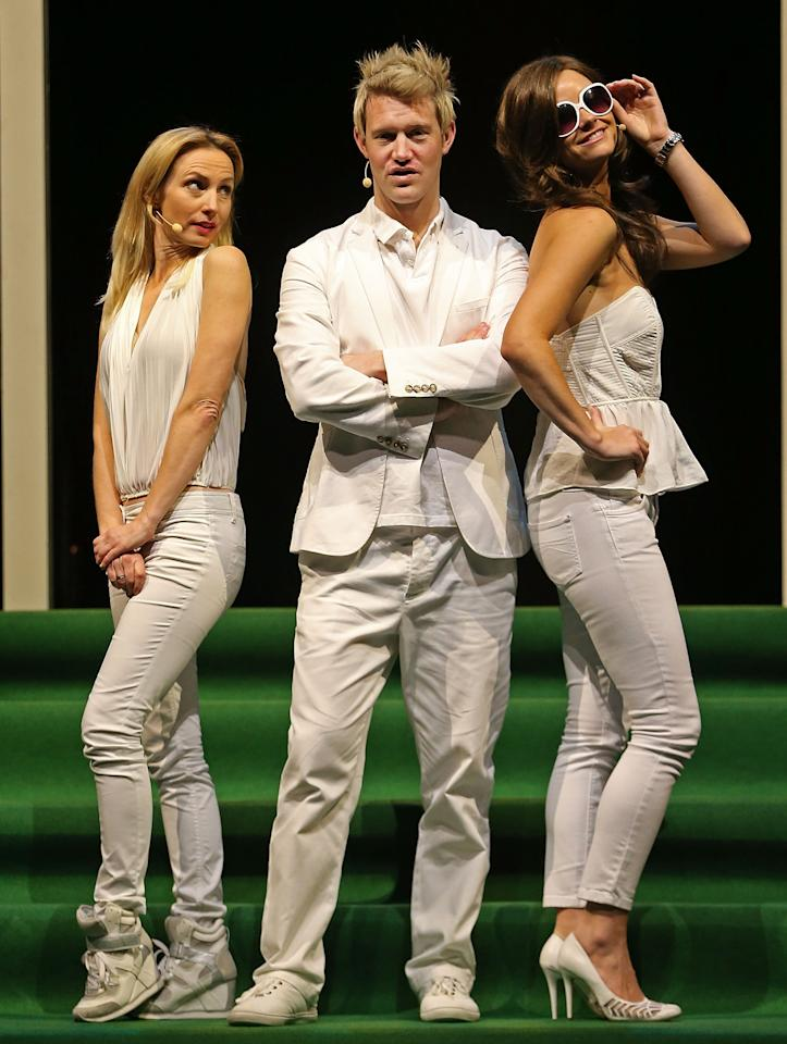 "MELBOURNE, AUSTRALIA - JUNE 20:  (L to R) Lisa McCune, who plays Simone Warne, Eddie Perfect who plays Shane Warne and Christie Whelan Brown who plays Elizabeth Hurley pose during a ""Shane Warne The Musical' media call at the Arts Centre Melbourne on June 20, 2013 in Melbourne, Australia. Shane Warne The Musical is a musical comedy based on the life of Australian cricketer Shane Warne.  (Photo by Scott Barbour/Getty Images)"