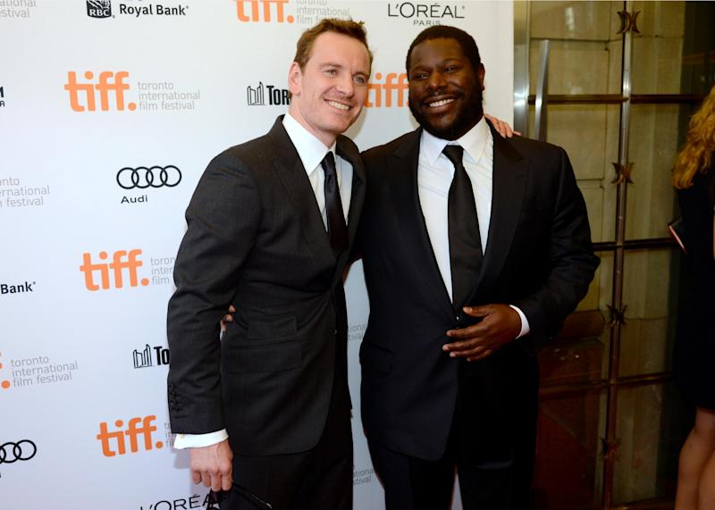 """Michael Fassbender, left, and director Steve McQueen arrive at the premiere for """"12 Years a Slave"""" on day 2 of the Toronto International Film Festival at The Princess of Wales Theatre on Friday, Sept. 6, 2013, in Toronto. (Photo by Chris Pizzelloi/Invision/AP)"""
