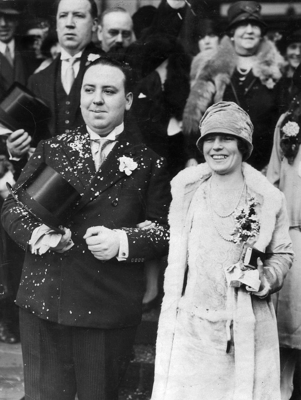 "<p>In December 1926, guests showered legendary director Alfred Hitchcock and Alma Reville after the two got ""hitch""-ed. </p>"