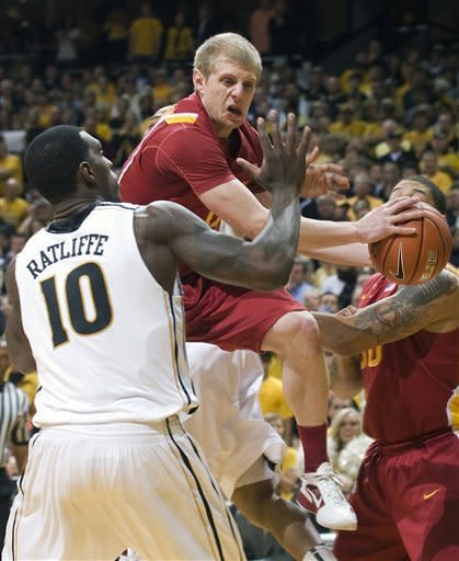 Iowa State's Scott Christopherson, center, passes around Missouri's Ricardo Ratliffe (10) as teammate Royce White, right, looks on during the first half of an NCAA college basketball game Wednesday, Feb. 29, 2012, in Columbia, Mo. (AP Photo/L.G. Patterson)