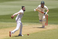 Australia's Travis Head, right, hits the ball past Indian bowler Shubman Gill during play on day one of the Boxing Day cricket test between India and Australia at the Melbourne Cricket Ground, Melbourne, Australia, Saturday, Dec. 26, 2020. (AP Photo/Asanka Brendon Ratnayake)