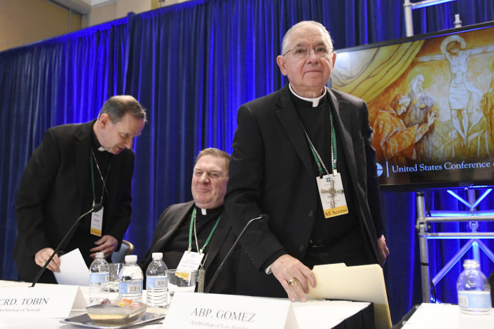 """FILE - In this Tuesday, Nov. 12, 2019, file photo, Archbishop Jose H. Gomez, right, of Los Angeles, with Bishop Michael F. Burbidge, left, of Arlington, Va., and Cardinal Joseph William Tobin, of Newark, N.J., exits a news conference after being elected president of the United States Conference of Catholic Bishops during their Fall General Assembly in Baltimore. On Tuesday, Nov. 17, 2020, Gomez addressed an online national meeting of bishops. During the previous week, Gomez congratulated Joe Biden on his presidential election victory. Now, Gomez is sounding a different tone, saying some of Biden's policy positions, including support for abortion rights, pose a """"difficult and complex situation"""" for the church. (AP Photo/Steve Ruark, File)"""