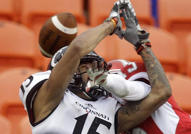 Cincinnati wide receiver Chris Moore (15) has a pass broken up in the end zone by Houston cornerback Thomas Bates during the first half of a NCAA football game at BBVA Compass Stadium on Saturday, Nov. 23, 2013, in Houston. (AP Photo/Houston Chronicle, J. Patric Schneider)