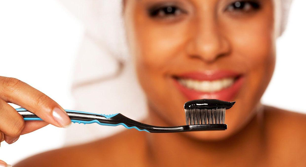 Charcoal toothpaste could be harming your teeth. [Photo: Getty]
