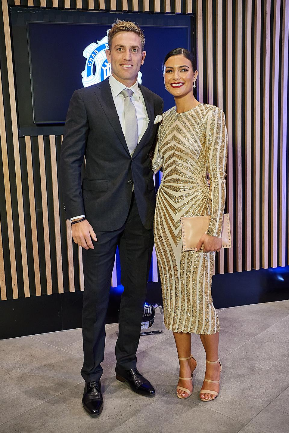 Brad Sheppard and partner Ellen Taylor-Hawkins pose for a photo during the 2020 Brownlow Medal Count at Optus Stadium on October 18, 2020 in Perth, Australia.