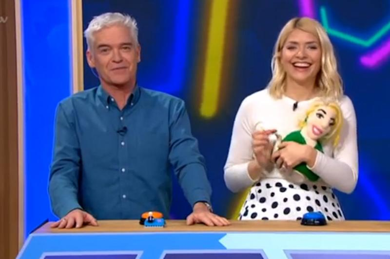 Prize: Holly Willoughby clutches her Holly Willoughby tea cosy (ITV)