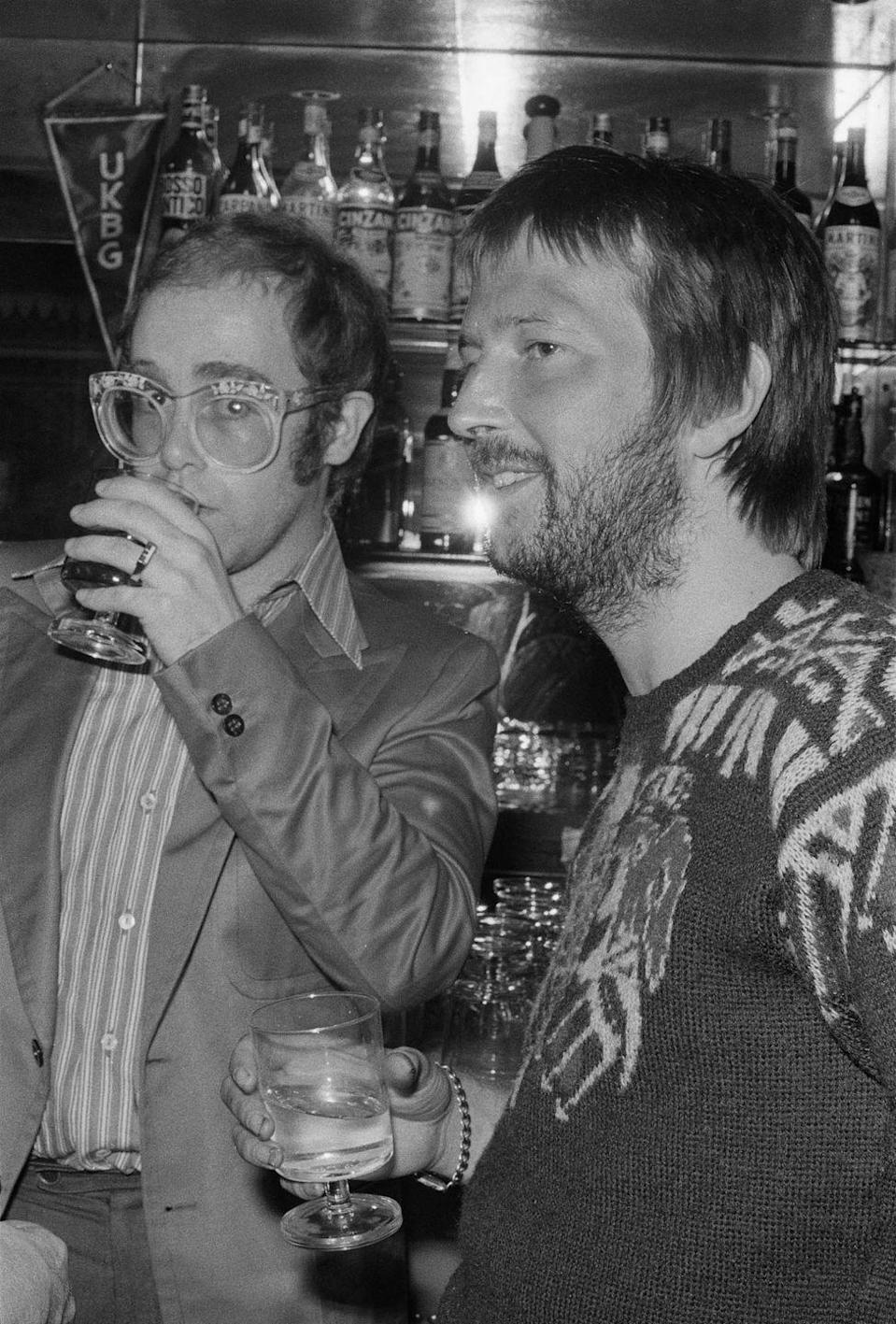 <p>Elton John with Eric Clapton, at a special party to Mark Clapton 's return to recording and live performance at the China Garden in Soho, London, April 11, 1974.</p>
