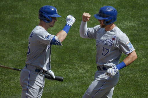 Kansas City Royals' Hunter Dozier (17) celebrates with Ryan O'Hearn (66) after hitting a solo home run against the Minnesota Twins in the first inning of a baseball game Sunday, Aug. 16, 2020, in Minneapolis. (AP Photo/Bruce Kluckhohn)