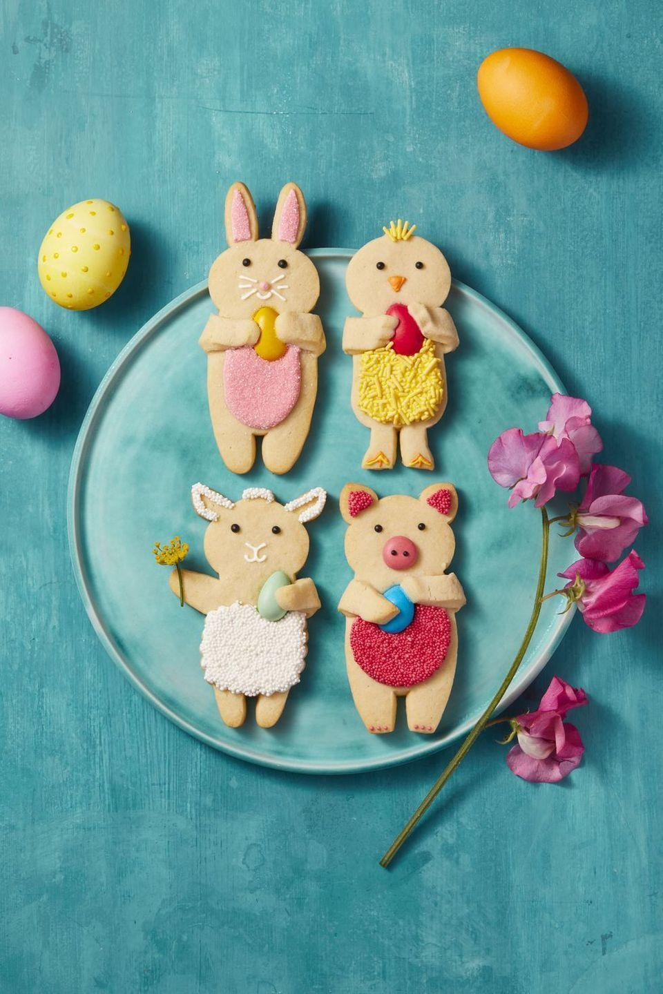 """<p>What says """"Easter"""" more than cookies shaped as adorable farm animals? These cute animal treats made from classic vanilla sugar cookie dough are easily dressed up with colorful frosting (and sprinkles!). </p><p><em><a href=""""https://www.goodhousekeeping.com/food-recipes/a41691/vanilla-sugar-dough-recipe/"""" rel=""""nofollow noopener"""" target=""""_blank"""" data-ylk=""""slk:Get the recipe for Easter Vanilla Sugar Cookies »"""" class=""""link rapid-noclick-resp"""">Get the recipe for Easter Vanilla Sugar Cookies »</a></em></p><p><strong>RELATED: </strong><a href=""""https://www.goodhousekeeping.com/holidays/easter-ideas/g26557097/easy-easter-desserts/"""" rel=""""nofollow noopener"""" target=""""_blank"""" data-ylk=""""slk:50+ Easy Easter Desserts That Celebrate Spring In a Big Way"""" class=""""link rapid-noclick-resp"""">50+ Easy Easter Desserts That Celebrate Spring In a Big Way</a></p>"""
