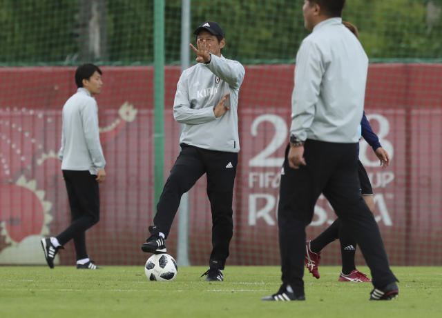 Japan's head coach Akira Nishino, center, gestures during a training session of Japan national soccer team at the 2018 soccer World Cup in Kazan, Russia, Thursday, June 14, 2018. (AP Photo/Eugene Hoshiko)