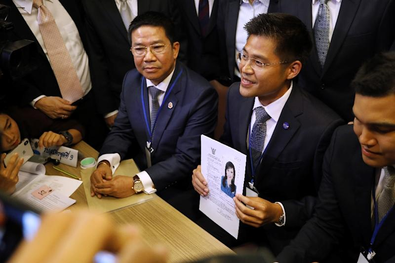 A party official holds a registration document bearing the image of Thai Princess Ubolratana, who will run for PM (AFP Photo/Krit Phromsakla Na SAKOLNAKORN)