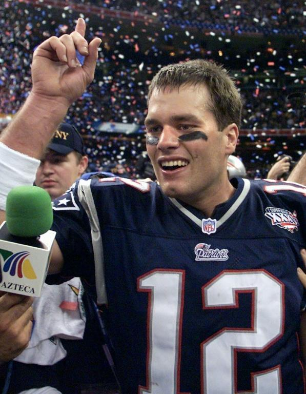 Tom Brady celebrates his first Super Bowl win in 2002 following New England's 20-17 defeat of the St. Louis Rams