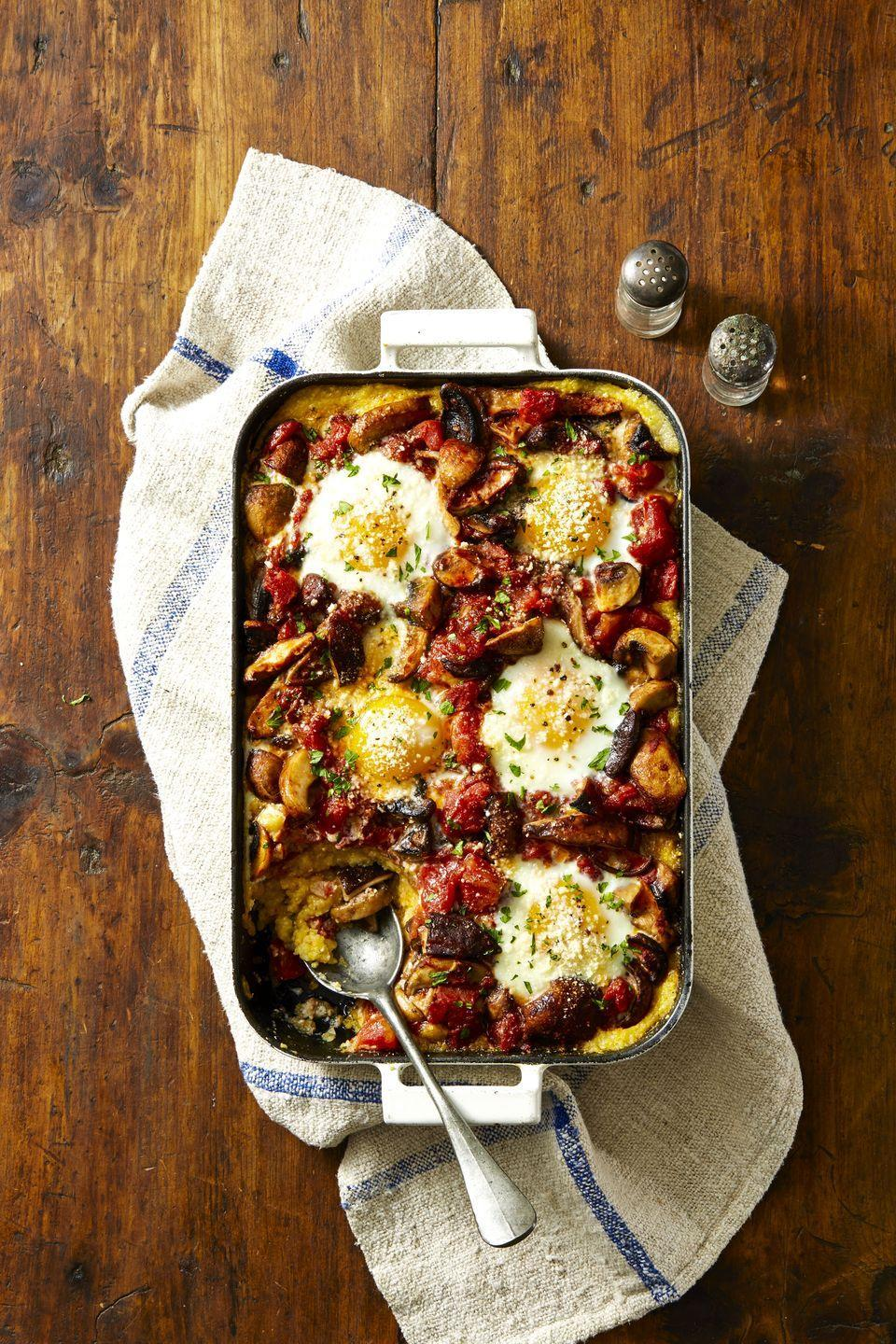 "<p>This bake includes tomatoes, eggs, and mushrooms. Eat it for breakfast, brunch or dinner, you decide. </p><p><em><a href=""https://www.goodhousekeeping.com/food-recipes/a42214/mushroom-ragu-and-polenta-egg-bake-recipe/"" rel=""nofollow noopener"" target=""_blank"" data-ylk=""slk:Get the recipe for Mushroom Ragu and Polenta Egg Bake »"" class=""link rapid-noclick-resp"">Get the recipe for Mushroom Ragu and Polenta Egg Bake » </a></em><br></p>"