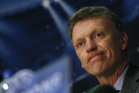 Moyes looks on during a news conference at Old Trafford