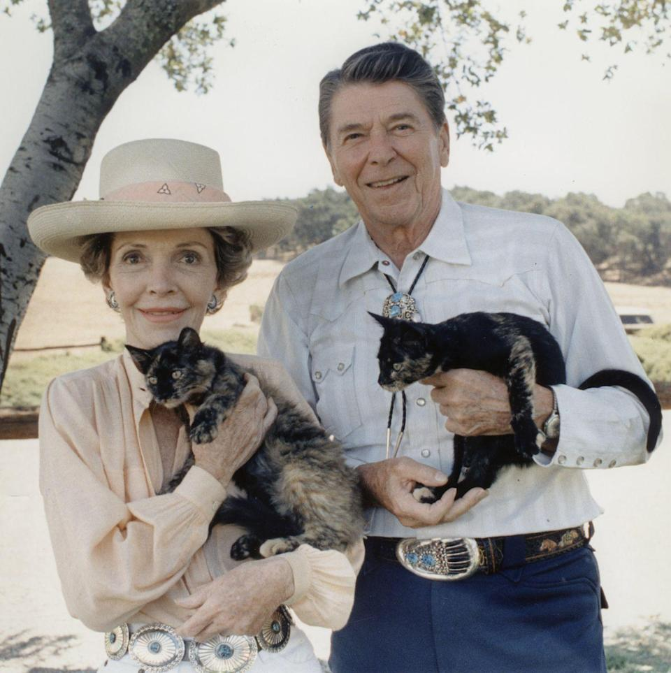 <p>Posing for a photo with their cats, the Reagans paid another visit to their Santa Barbara ranch. </p>