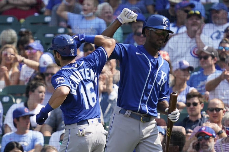 Kansas City Royals' Andrew Benintendi, left, celebrates with Michael A. Taylor after hitting a solo home run in the sixth inning of a baseball game against the Chicago Cubs, Friday, Aug. 20, 2021, in Chicago. (AP Photo/Nam Y. Huh)