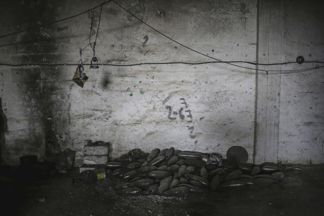 <p>Mortars are piled up on the floor inside a weapon factory belonging to the Islamic State group in western Mosul, May 11, 2017. The factory was discovered by Iraqi Federal Police forces after they liberated the area. (Photo: Bram Janssen/AP) </p>