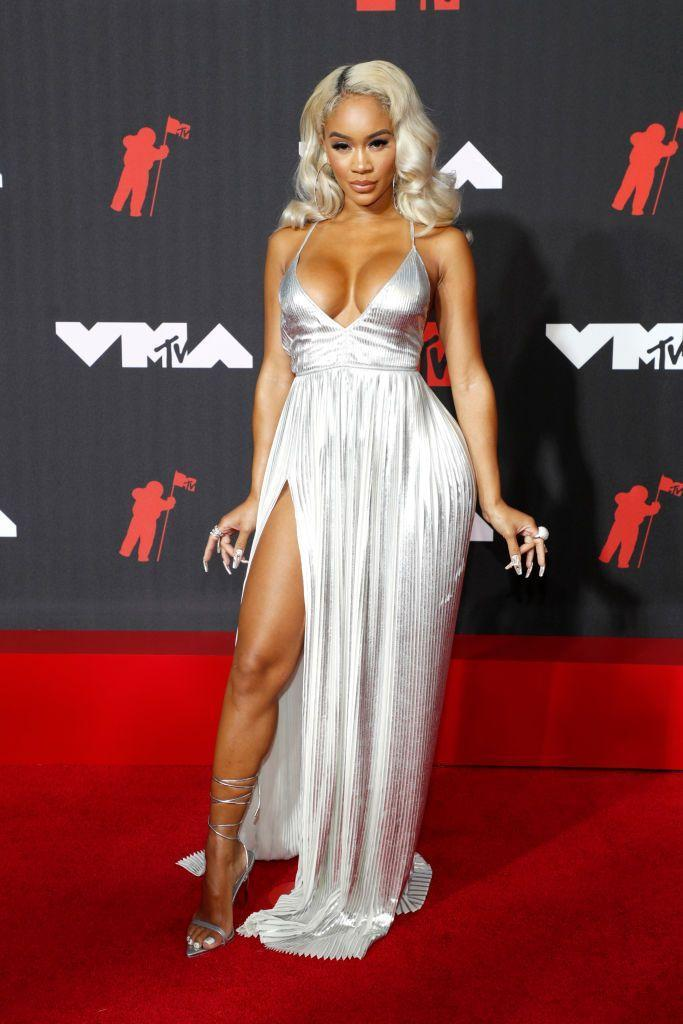 <p>The rapper wore a silver gown by Valentino.</p>