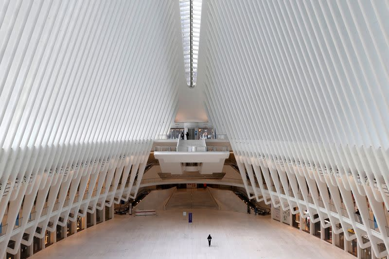 Man walks alone through Oculus transportation hub during outbreak of the coronavirus disease (COVID-19) in New York