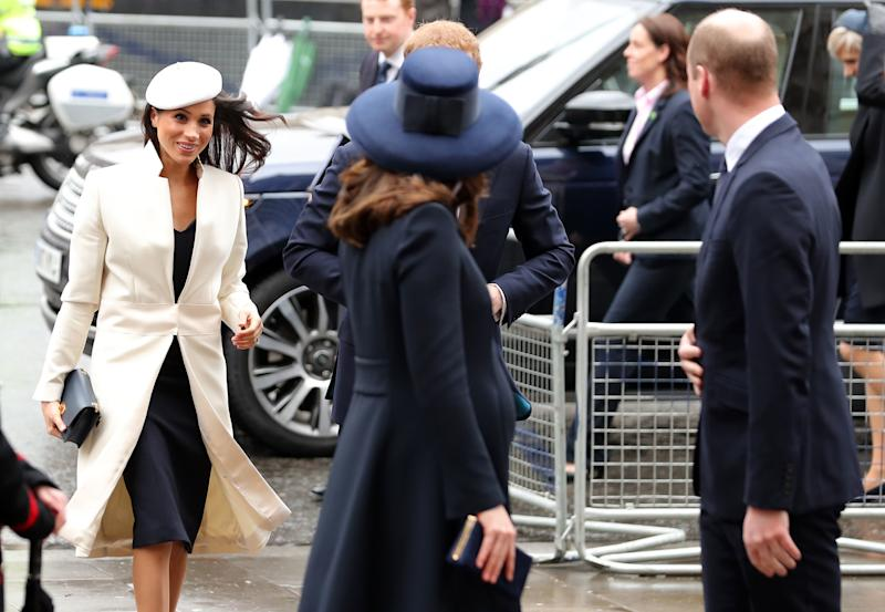 Meghan Markle makes her way into the service behind Prince William, the Duke of Cambridge, and his wife, Catherine, Duchess of Cambridge. (DANIEL LEAL-OLIVAS via Getty Images)