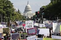 Women's rights activists marching to the US Capitol to protest the restrictive new abortion law in Texas (AFP/JOSHUA ROBERTS)