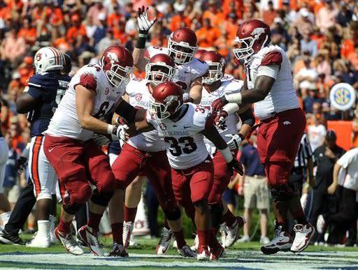 Arkansas's Dennis Johnson (33) celebrates with teammates after scoring a touchdown against Auburn during the first half of an NCAA college football game on Saturday, Oct. 6, 2012 in Auburn, Ala.(AP Photo/Todd J. Van Emst)