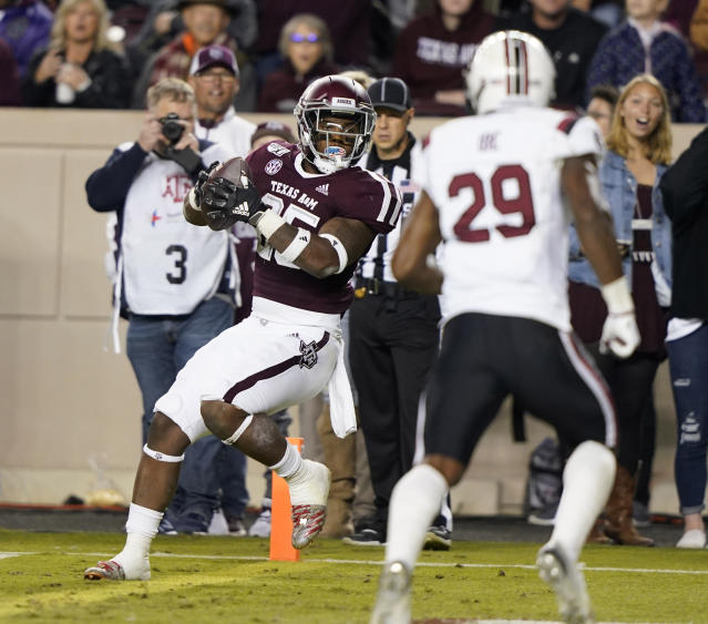 Texas A&M running back Cordarrian Richardson, left, catches a pass for a touchdown as South Carolina defensive back J.T. Ibe (29) defends during the second quarter of an NCAA college football game Saturday, Nov. 16, 2019, in College Station, Texas. (AP Photo/David J. Phillip)