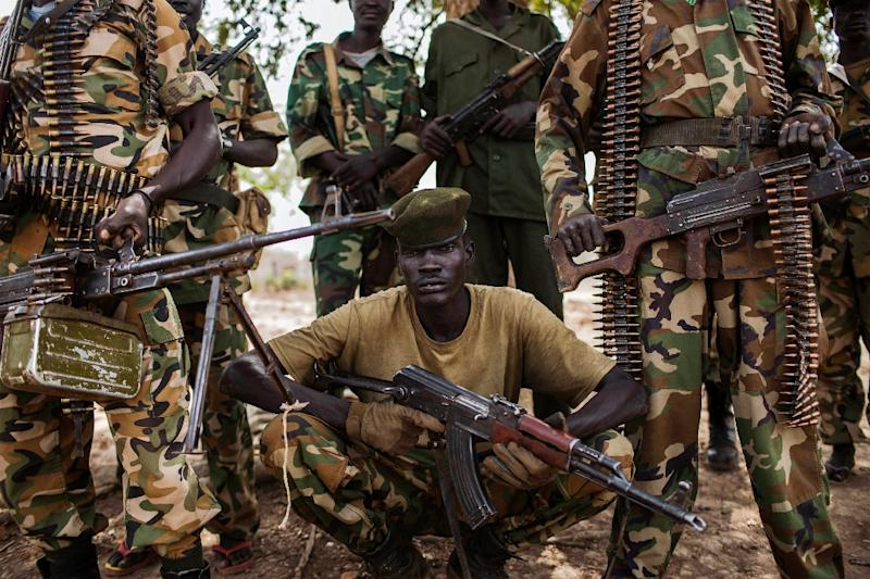 Sudan People's Liberation Army (SPLA), South Sudan government soldiers, from the 2nd Battalion pose at the SPLA headquarters in Nyang, in the county of Yirol East, South Sudan, on February 15, 2014 (AFP Photo/Fabio Bucciarelli)