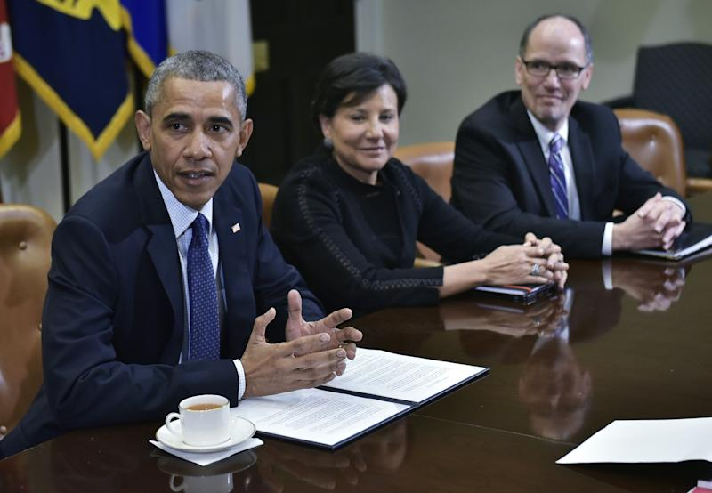 US President Barack Obama speaks following a meeting with his economic team in the Roosevelt Room of the White House on March 4, 2016 in Washington, DC. From center is Commerce Secretary Penny Pritzker, and Labor Secretary Thomas Perez. / AFP / Mandel Ngan (Photo credit should read MANDEL NGAN/AFP via Getty Images)