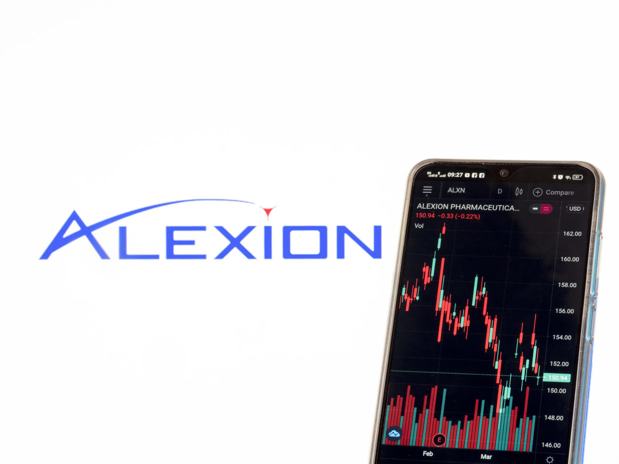 In this photo illustration the stock market information of Alexion Pharmaceuticals Inc. seen displayed on a smartphone with the Alexion Pharmaceuticals Inc. logo in the background. (Photo by Igor Golovniov / SOPA Images/Sipa USA)