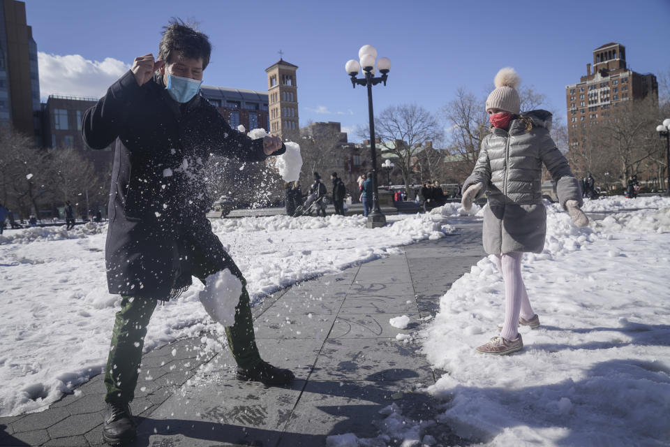 New York State Senator Brad Hoylman, left, plays in the snow with his daughter Silvia Hoylman-Sigal, 10, who was born through surrogacy, Saturday Feb. 6, 2021, in New York. Sen. Hoylman is the lead sponsor of a New York State law taking effect on Feb. 15 that legalizes commercial surrogacy. (AP Photo/Bebeto Matthews)