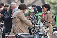 <p>While the duo are filming, they've been giving us the priceless gift of many photos together in costume. Here, Driver straddles a vespa while the pair get notes from director Ridley Scott. </p>
