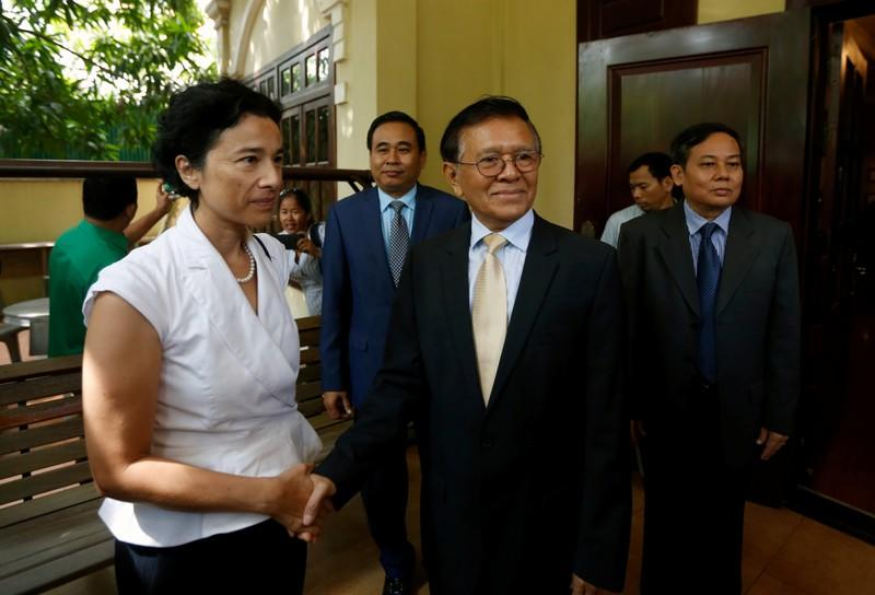 Leader of the CNRP Kem Sokha shakes hands with French Ambassador to Cambodia Eva Nguyen Binhin at his home in Phnom Penh