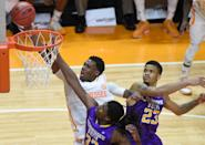 Tennessee guard Armani Moore (4) shoots a layup against Tennessee Tech forward Dennis Ogbe (33) and guard Ty Allen (23) during the second half of an NCAA college basketball game in Knoxville, Tenn. on Friday, Dec. 19, 2014. (AP Photo/Knoxville News Sentinel, Adam Lau)