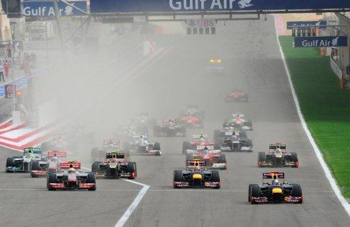 Red Bull Racing's German driver Sebastian Vettel leads (R) after the start