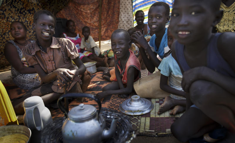 A family make tea outside their makeshift shelter at a United Nations compound which has become home to thousands of people displaced by the recent fighting, in the Jebel area on the outskirts of Juba, South Sudan Tuesday, Dec. 31, 2013. Anti-government rebels took control of nearly all of the strategic city of Bor on Tuesday even as officials announced that representatives from the government and the rebels had agreed to hold talks for the first time. (AP Photo/Ben Curtis)
