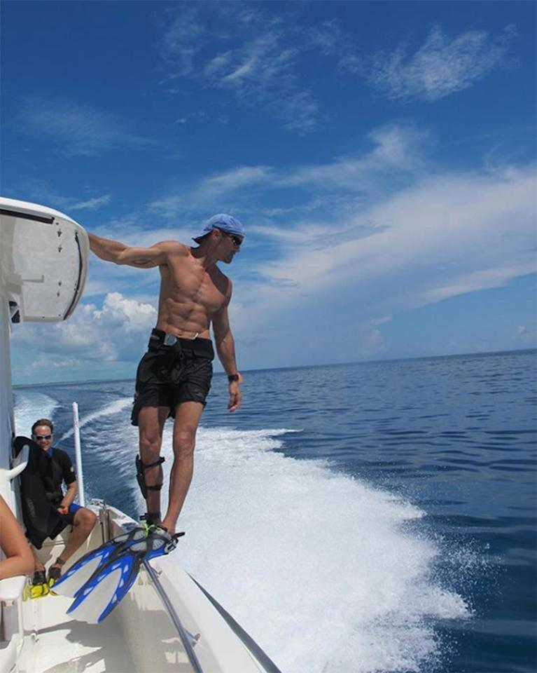 While Tim is looking for fish, we're looking at his abs.