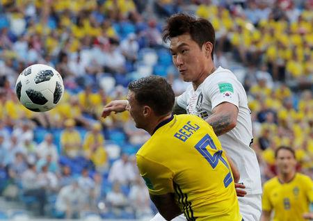 Soccer Football - World Cup - Group F - Sweden vs South Korea - Nizhny Novgorod Stadium, Nizhny Novgorod, Russia - June 18, 2018   South Korea's Jang Hyun-soo in action with Sweden's Marcus Berg      REUTERS/Carlos Barria