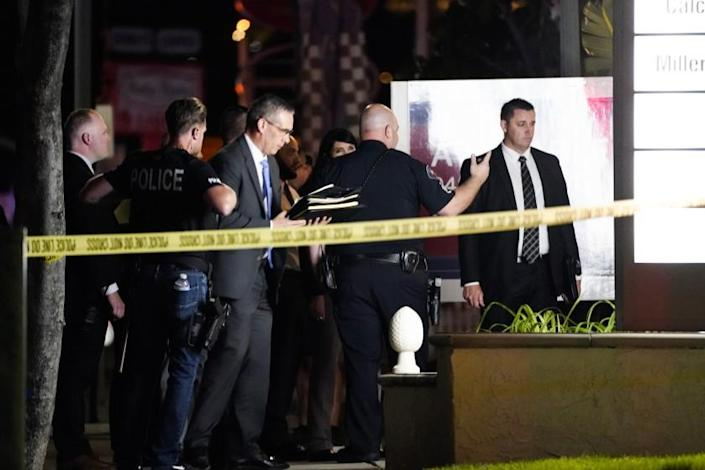 Orange, CA - March 31: Police respond to the scene of a multiple shooting on Saturday, March 31, 2021 in Orange, CA. (Kent Nishimura / Los Angeles Times)