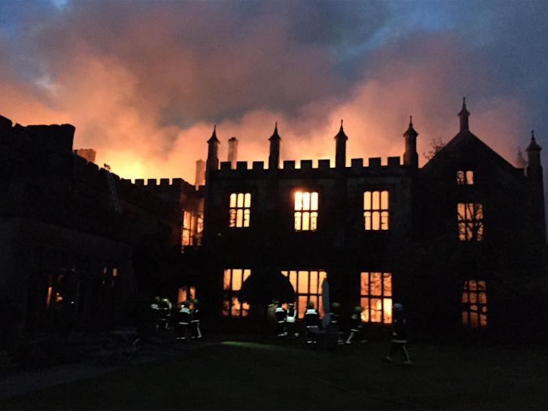 Parnham House, built in 1522, was consumed by flames in the early hours of Saturday morning: Craig Baker/ Dorset&Wiltshire Fire