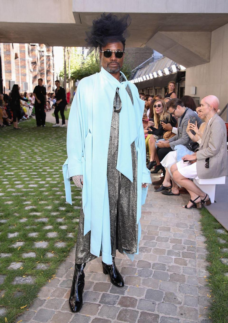 <p>The star wore a baby blue overcoat and grey printed dress to the Roland Mouret SS20 show at London Fashion Week.</p><p>He styled the look with a black tulle hat, black heeled boots and a pair of aviator-style sunglasses. <br></p>
