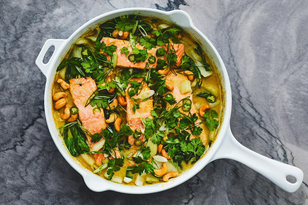 "Meet your new favorite, cold-weather one-pan salmon dinner. It's warm and creamy with coconut milk and just spicy enough with green curry paste, ginger, and garlic; plus, it's covered in lots of herbs and crunchy cashews. <a href=""https://www.epicurious.com/recipes/food/views/salmon-and-bok-choy-green-coconut-curry?mbid=synd_yahoo_rss"">See recipe.</a>"