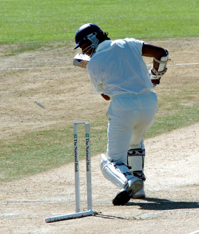 NEW ZEALAND - APRIL 06:  Sri Lanka's Kumar Sangakkara looks back on his wicket after being bowled by New Zealand's Chris Martin for 5 on the third day in the first cricket test at McLean Park Napier, New Zealand, Wednesday, April 06, 2005.  (Photo by Ross Setford/Getty Images)