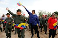 Venezuela President Nicolas Maduro (in blue) has held onto power thanks to support from the military high command
