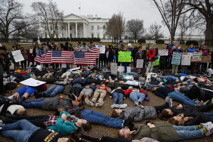 "Demonstrators participate in a ""lie-in"" outside the White House on Feb. 19. (Photo: AP/Evan Vucci)"