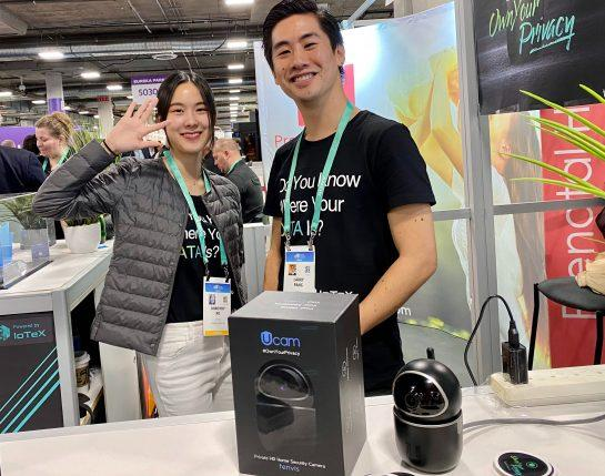 <small>IoTeX's Dorothy Ko and Larry Pang pose at the company's booth at CES 2020. (Photo by Brady Dale for CoinDesk)</small>